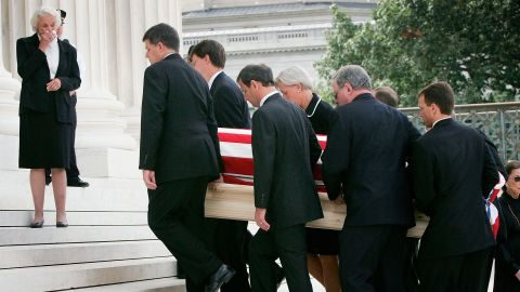 O'Connor weeps as Roberts and other pallbearers carry Rehnquist's casket into the Supreme Court. Roberts was once a law clerk for Rehnquist.