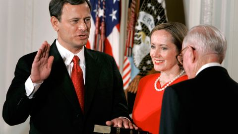 Roberts' wife, Jane, holds a Bible as her husband is sworn in by Supreme Court Justice John Paul Stevens.