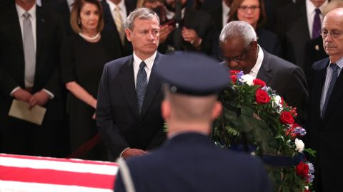 Roberts and Thomas pay their respects to the late President George H.W. Bush as he lies in state in December 2018.
