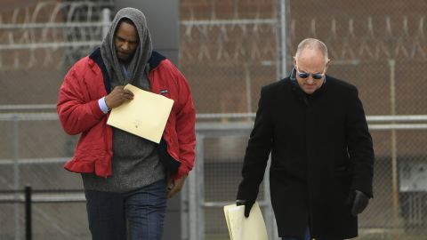 Singer R. Kelly left, walks with his attorney Steve Greenberg right, after being released from Cook County Jail, March 9, 2019, in Chicago. (AP Photo/Paul Beaty)