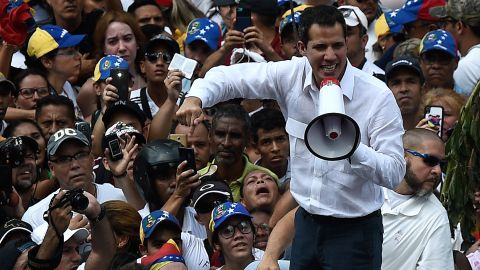 Guaido addresses supporters through a megaphone.