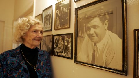 Julia Ruth Stevens, daughter of Babe Ruth, looks at a photograph of her father at her home in Sun City, Arizona, in 2006.