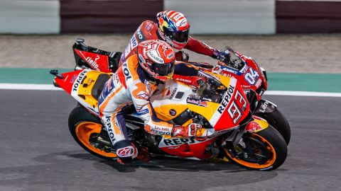 Dovizioso and Marquez go wheel-to-wheel in a thrilling race in Qatar.