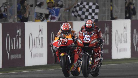 Andrea Dovizioso beats Marc Marquez on the line in Qatar.