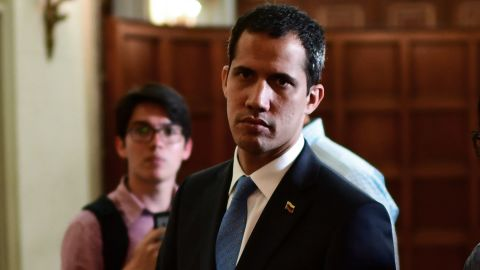 Venezuelan opposition leader and self-proclaimed acting president Juan Guaido arrives to attend a session at the Venezuelan National Assembly in Caracas on March 11, 2019.