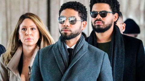 """Actor Jussie Smollett(C) and team arrive for a court hearing at the Leighton Criminal Courthouse on March 12, 2019 in Chicago. - A Chicago grand jury on March 8, 2019 indicted American actor Jussie Smollett on 16 felony counts after allegedly lying to police about being the victim of a racist, homophobic hate crime. Police say Smollett -- who gained fame on Fox musical drama """"Empire"""" -- staged the attack in a bid to gain publicity and a bigger paycheck. (Photo by DEREK HENKLE / AFP)        (Photo credit should read DEREK HENKLE/AFP/Getty Images)"""
