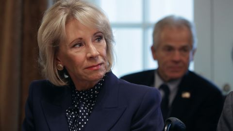 WASHINGTON, DC - FEBRUARY 12: Education Secretary Betsy DeVos listens to U.S. President Donald Trump talk to reporters during a cabinet meeting in the Cabinet Room at the White House February 12, 2019 in Washington, DC. Trump said he was not happy about the compromise legislation agreed to by Republicans and Democrats that would prevent a new partial federal government shutdown but said he would accept the deal. (Photo by Chip Somodevilla/Getty Images)