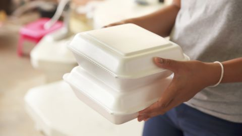 Hand holding foam boxes rice.; Shutterstock ID 398346931; Job: -