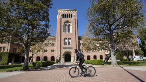 LOS ANGELES, CALIFORNIA - MARCH 12:   A view of people visiting the University of Southern California on March 12, 2019 in Los Angeles, California. Federal prosecutors say their investigation dubbed Operation Varsity Blues blows the lid off an audacious college admissions fraud scheme aimed at getting the children of the rich and powerful into elite universities. According to prosecutors, wealthy parents paid a firm to help their children cheat on college entrance exams and falsify athletic records of students to enable them to secure admission to schools such as UCLA, USC, Stanford, Yale and Georgetown. Two USC athletic department employees a high-ranking administrator and a legendary head coach were fired Tuesday after being indicted in federal court in Massachusetts for their alleged roles in a racketeering conspiracy that helped students get into elite colleges and universities by falsely designating them as recruited athletes.  (Photo by Allen J. Schaben / Los Angeles Times via Getty Images)