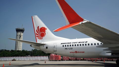A grounded Lion Air Boeing Co. 737 Max 8 aircraft sits on the tarmac at terminal 1 of Soekarno-Hatta International Airport in Cenkareng, Indonesia, on Tuesday, March 15, 2019. Sundays loss of an Ethiopian Airlines Boeing 737, in which 157 people died, bore similarities to the Oct. 29 crash of another Boeing 737 Max plane, operated by Indonesias Lion Air, stoking concern that a feature meant to make the upgraded Max safer than earlier planes has actually made it harder to fly. Photographer: Dimas Ardian/Bloomberg via Getty Images