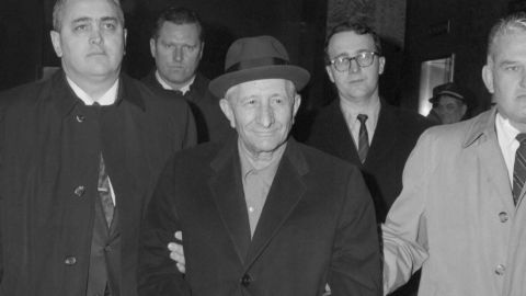 """Flanked by FBI agents, Carlo Gambino, 67, reputed to be the Maria's """"Boss of all Bosses,"""" is led from FBI headquarters after he was arrested for plotting to rob the crew of an armored car containing six million dollars. The robbery never took place, a spokesman said. No other details except the owner of the truck, US Trucking Company, were released. Gambino, the FBI said, is one of the most powerful Mafioso in the US."""