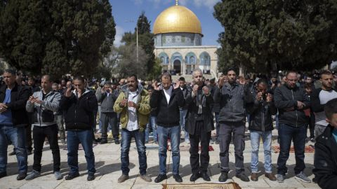 People pray for the victims at the al-Aqsa Mosque on Friday, March 15, in Jerusalem.