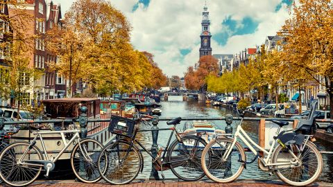 <strong>5. The Netherlands. </strong>No matter the season, residents bike all over the city of Amsterdam, where visitors can stroll over over the canals that protect the city.