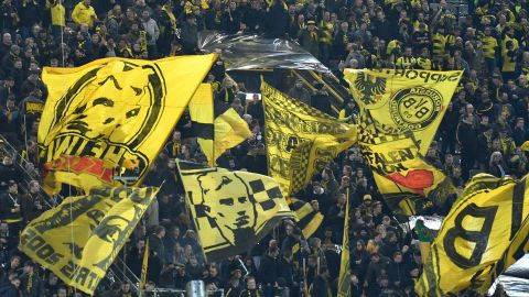 Dortmund fans wave flags prior to the UEFA Champions League round of 16 second leg football match between BVB Borussia Dortmund and Tottenham Hotspur on March 5, 2019 in Dortmund, western Germany. (Photo by John MACDOUGALL / AFP)        (Photo credit should read JOHN MACDOUGALL/AFP/Getty Images)