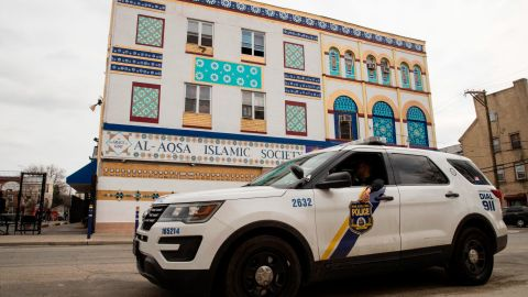 In the wake of the deadly attack against two mosques in New Zealand, police officers sit in their vehicle out side the Al Aqsa Islamic Society mosque in Philadelphia, ahead of prayers Friday, March 15, 2019. (AP Photo/Matt Rourke)