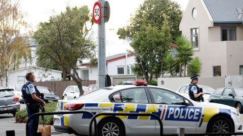 Police officers secure the area in front of the Masjid al Noor mosque after a shooting in Christchurch on Friday.