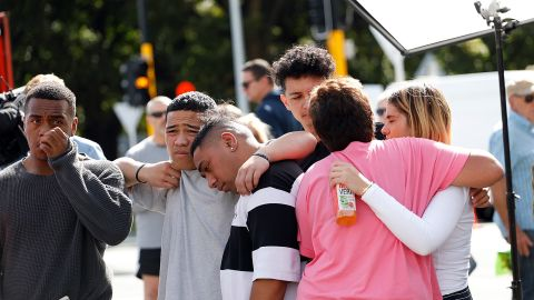 """Residents get emotional as they pay respect by placing flowers for the victims of the mosques attacks in Christchurch on March 16, 2019. - New Zealand's prime minister vowed to toughen the country's gun laws after revealing Saturday that the man accused of murdering 49 people in two mosques legally purchased the arsenal of firearms used in the massacre. Jacinda Ardern said the gunman, 28-year-old Australian Brenton Tarrant, obtained a """"Category A"""" gun licence in November 2017 and began purchasing the five weapons used in Friday's attacks in the southern city of Christchurch the following month. (Photo by Tessa BURROWS / AFP)        (Photo credit should read TESSA BURROWS/AFP/Getty Images)"""