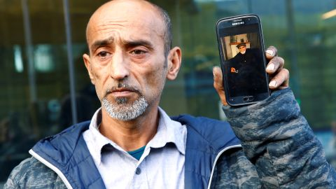 Omar Nabi, standing at the district court in Christchurch, speaks to the media about losing his father, Haji Daoud, in the mosque attacks.