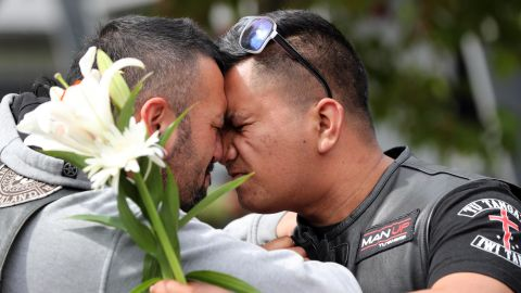 People mourn March 16 at Hagley College in Christchurch.