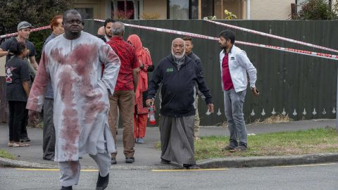 Linwood Ave Christchurch. PHOTO Survivor with blood stained clothes from the shooting comes through the cordon. Christchurch shooting.