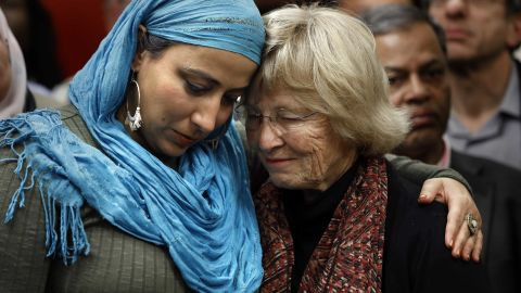 Najeeba Syeed, left, hugs Judy Gilliland at the Islamic Center of Southern California in Los Angeles, where people of all faiths came together in prayer March 16.