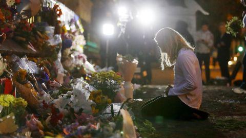 A woman visits a makeshift memorial in Christchurch.