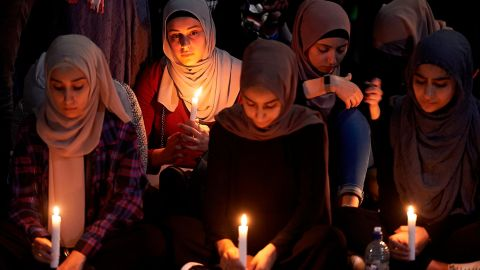 A candlelight prayer is held outside the State Library of Victoria, in Australia, on Saturday, March 16.