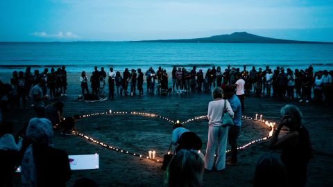 Crowds gather on Takapuna Beach in Auckland, New Zealand, on March 16 for a vigil for the victims of the Christchurch attacks.