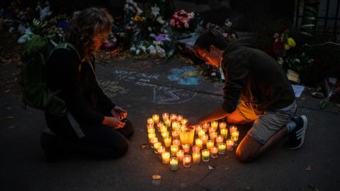 People light candles next to the Botanic Gardens in Christchurch on March 17.