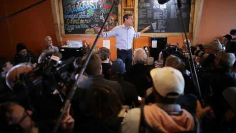 Democratic presidential candidate Beto O'Rourke stands on a counter top as he talks with voters during his second day of campaigning for the 2020 nomination at Central Park Coffee Company March 15, 2019 in Mount Pleasant, Iowa. After losing a long-shot race for U.S. Senate to Ted Cruz (R-TX), the 46-year-old O'Rourke is making his first campaign swing through Iowa after jumping into a crowded Democratic field this week. (Photo by Chip Somodevilla/Getty Images)
