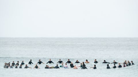 Local surfers and surfers competing in the Sydney Surf Pro participate in a paddle-out, wreath laying and observe a minute of silence to remember victims of the Christchurch mosque attacks at Manly Beach on March 17 in Sydney, Australia.