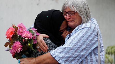 Women embrace near Masjid Al Noor mosque in Christchurch, New Zealand, on March 17.