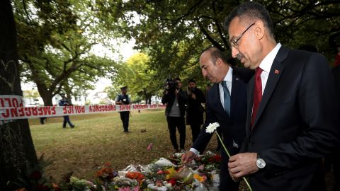Vice President of Turkey, Fuat Oktay (right), and Minister of Foreign Affairs of Turkey, Mevlut Cavusoglu, lay flowers during their March 18 visit to Al Noor mosque, which was targeted in Friday's twin terror attacks in Christchurch, New Zealand.