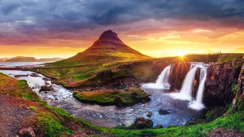 <strong>4. Iceland. </strong>Fourth place Iceland offers hot springs and stunning waterfalls, like this one at Kirkjufell mountain, that appear otherworldly.