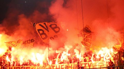 BRUGGE, BELGIUM - SEPTEMBER 18:   Borussia Dortmund fans light flares during the Group A match of the UEFA Champions League between Club Brugge and Borussia Dortmund at Jan Breydel Stadium on September 18, 2018 in Brugge, Belgium.  (Photo by Dean Mouhtaropoulos/Getty Images)
