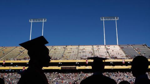 Arizona State University graduate students are silhouetted during their graduation at Sun Devil Stadium May 13, 2009, in Tempe, Arizona.