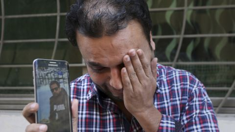 A relative weeps while showing the picture of Sohail Shahid, a Pakistani citizen who was killed in the Christchurch mosque shootings, on his cell phone outside his home in Lahore, Pakistan, Sunday, March 17. Pakistan's foreign ministry spokesman says three more Pakistanis have been identified among the dead, increasing the number of Pakistanis to nine killed in the mass shootings at two mosques in the New Zealand city of Christchurch.