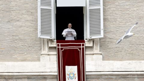 """Pope Francis reads his message during the Angelus noon prayer from the window of his studio overlooking St. Peter's Square at the Vatican, Sunday, March 17. Francis has offered prayers for """"our Muslim brothers"""" killed in the attack against two mosques in Christchurch, New Zealand."""