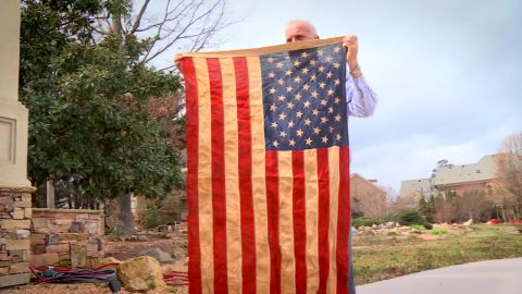 Richard Oulton holds the American flag that flew over his bunker during the Vietnam War.