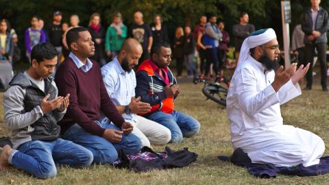 Mufti Zeeyad Ravat, right, a Muslim leader from Melbourne, leads a prayer at the Deans Avenue memorial, near the Al Noor mosque in Christchurch, New Zealand, on Tuesday, March 19.