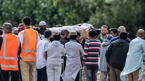 Mourners carry the coffin of a shooting victim during a funeral at the Memorial Park Cemetery in Christchurch on Wednesday, March 20. Hundreds of mourners gathered for the first funerals of those killed as New Zealanders braced for days of emotional farewells.