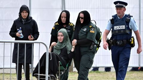 A mourner in a wheelchair leaves Memorial Park Cemetery on March 20 after attending a funeral for victims killed in the mosque massacre in Christchurch, New Zealand. A Syrian refugee and his son were buried in the first funerals for those killed in the attack as New Zealanders braced for days of emotional farewells following the mass slayings.