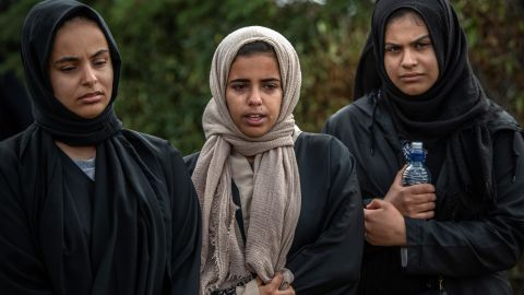 Women mourn at Memorial Park Cemetery on March 20 after attending the funerals of two victims of the Christchurch terrorist attack.