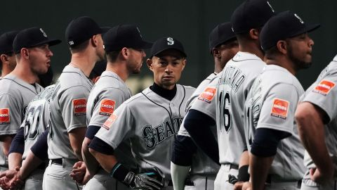 Ichiro lines up with his teammates for the national anthems prior to Wednesday's game.