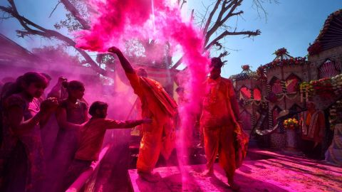 """<strong>Mathura, India: </strong>Revelers<strong> </strong>cover each other in colorful powders during the ancient Hindu festival of Holi, a two-day event held across India and Nepal which celebrates the beginning of spring and the triumph of good over evil. Click through <a href=""""https://cnn.com/travel"""" target=""""_blank"""">CNN Travel</a>'s gallery for more of the world's best travel photos that we'll collect and display in 2019:"""