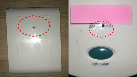 Cameras found by police hidden inside a hotel wall outlet (left) and hair dryer stand (right).