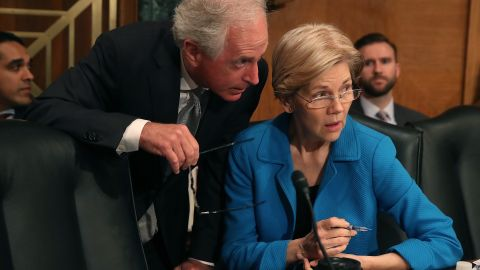 US Sen. Bob Corker talks with Warren during a Senate committee hearing in June 2017.