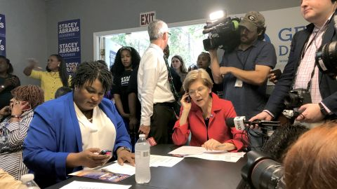 Warren helps Georgia gubernatorial candidate Stacey Abrams make calls to voters in October 2018.
