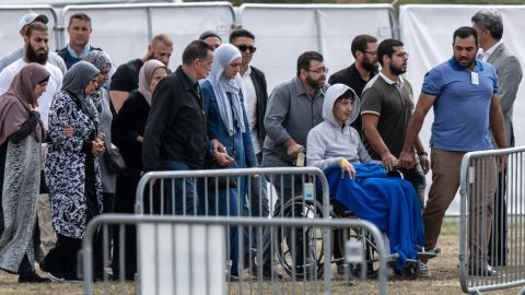 13-year-old Zaid Mustafa (in wheelchair) whose father and brother were killed in the Christchurch terrorist attack, attends a funeral at Memorial Park Cemetery on March 20, 2019 in Christchurch, New Zealand.