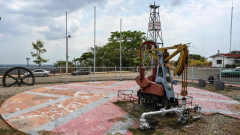 """View of the """"Zumaque I"""" pumpjack with which production was started in 1914 in Mene Grande, Zulia state, Venezuela on March 15, 2019. - Production cutbacks by OPEC nations are building a supply cushion that could be called upon to mitigate a possible supply shock from an abrupt drop in crisis-hit Venezuela's output, the International Energy Agency (IEA) said Friday. (Photo by Juan BARRETO / AFP)        (Photo credit should read JUAN BARRETO/AFP/Getty Images)"""